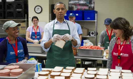 Obama making sandwiches